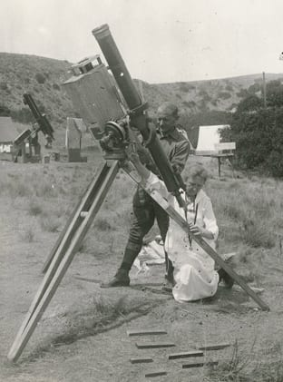 Harriet Bigelow and Charles Ridell adjust telescope for eclipse